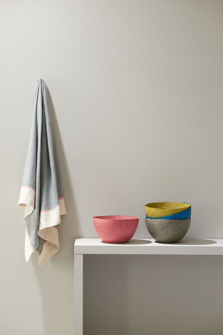 The subtle pink stripe at each end of this Ethiopian beach towel compliments the Swazi papier-mache bowl perfectly!