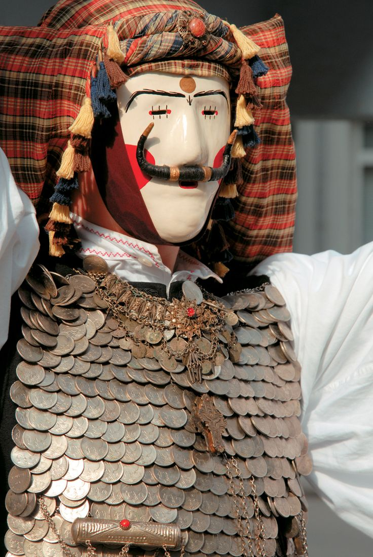 """Greek man dressed in a traditional carneval costume for the """"Boules"""" that takes part in Naoussa every year."""