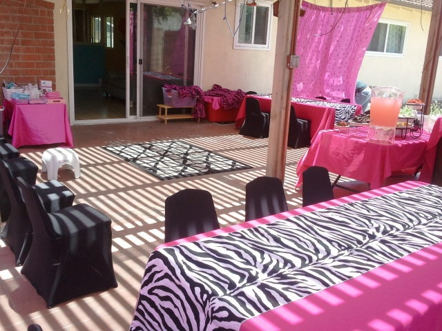 pink and zebra spa party, spa party set up, spa party pedicure station, spa party decorations, spa party activities, kids spa party robes, kids sized tables and chairs with custom chair covers, kids party rental, www.themesforkidspartyrental.com in Orange County, Costa Mesa, California