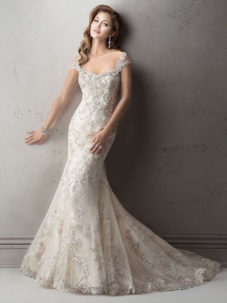 Sottero and Midgley - ETTIENE, Exquisite beaded embroidered lace on tulle drapes over delustered satin in this fit and flare wedding dress featuring dazzling Swarovski crystals on the neckline and shoulder straps.  Complete with scoop neckline and finished with crystal button and zipper over inner corset closure.