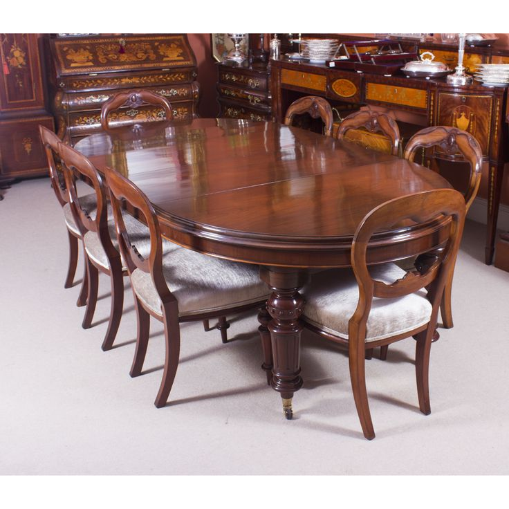 A beautiful antique Victorian oval dining table and a set of 8 antique balloon back chairs.