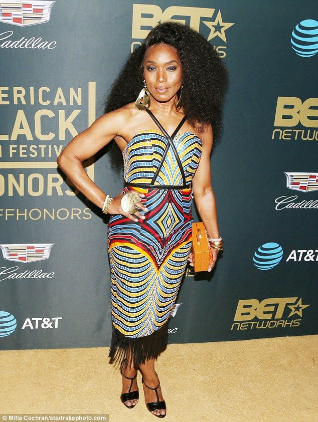 Wow factor: Angela Bassett channeled the African queen she played in Black Panther to present an award at American Black Film Festival Honors in Beverly Hills on Sunday night