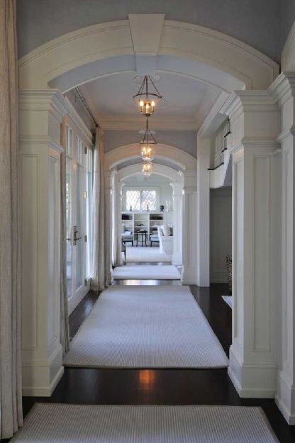 thefoodogatemyhomework:    Gorgeous millwork in this light blue hallway in East Hampton, NY. When your builder is this good, you don't need a ton of decoration.  (via BrownHarrisStevens)