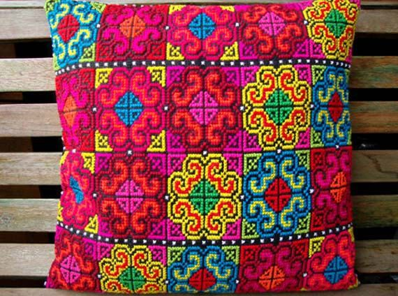 handmade embroidered pillow cover,yellow, blue, red, pink, green. $158.00, via Etsy.