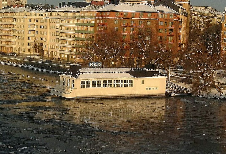 Liljehollmsbadet in Stockholm, Sweden is a bathhouse built on a pontoon built in 1929. The 20 meter pool is maintained at 30 degrees C, has regular sessions with classical music accompaniment, and has a balcony for sunbathing and sauna. Aaah.