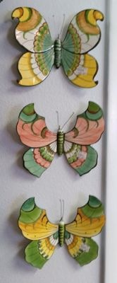 Ceramic butterflies from Portugal brighten a wall space. 9x9 inches. $28 each.