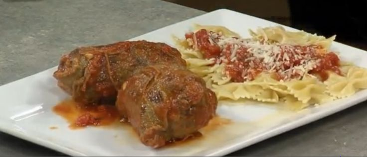 Braciole made with pine nuts, sausage or hard boiled eggs with sauce