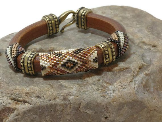 Brown Regaliz leather bracelet embellished with peyote stitched tubes made with Miyuki Delicas.