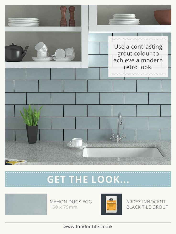 Brick tiles in duck egg blue with dark grouting.