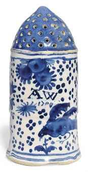 AN ENGLISH DELFT BLUE AND WHITE DATED SUGAR-CASTOR