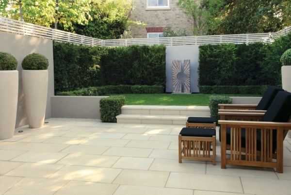 Stonemarket clean and sleek paved garden. Natural sandstone and sculpture