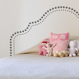 A Decal/Painted headboard - not a fan of the dot pattern or the shape, but the overall concept is intriguing.