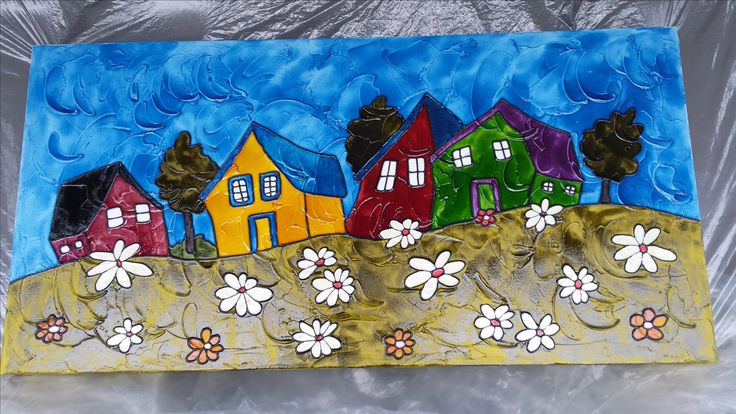 4 petites maisons de faux vitrail sur une toile.
