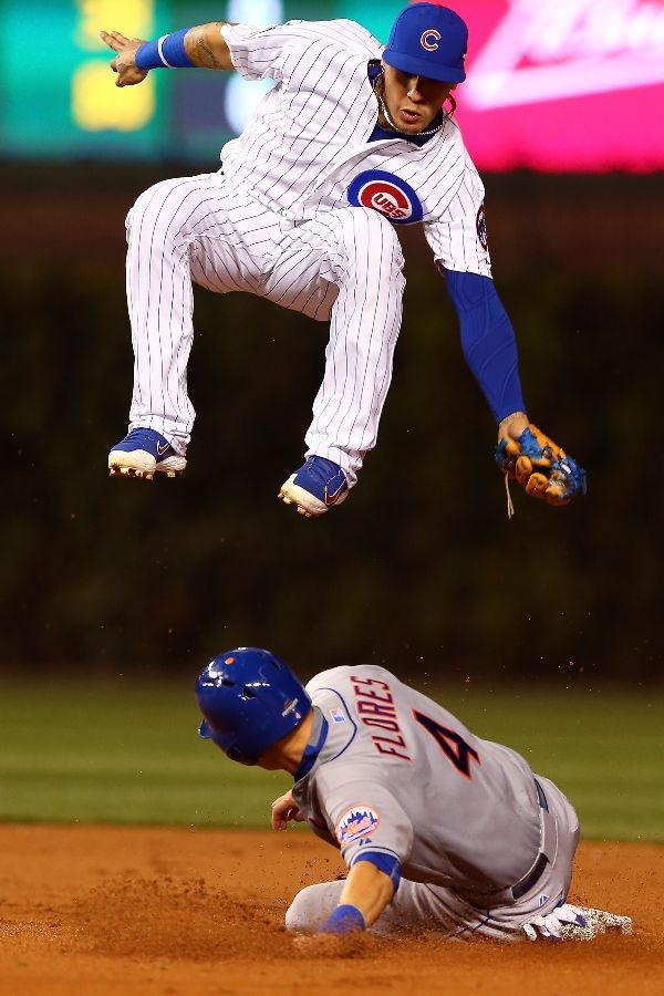 Javier Baez, CHC/Wilmer Flores, NYM///Game 4 NLCS , Oct 21, 2015   (elsa/getty images)