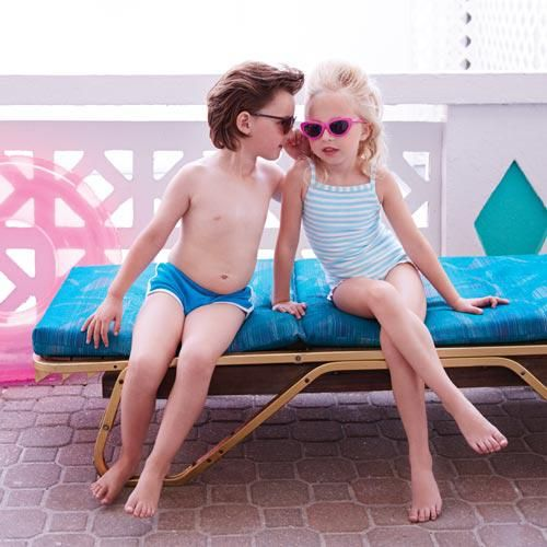 Models own shorts, Sons + Daughters sunglasses; Lilo Tati by Lisa Lozano striped terry one-piece, pink sunglasses by Appaman.