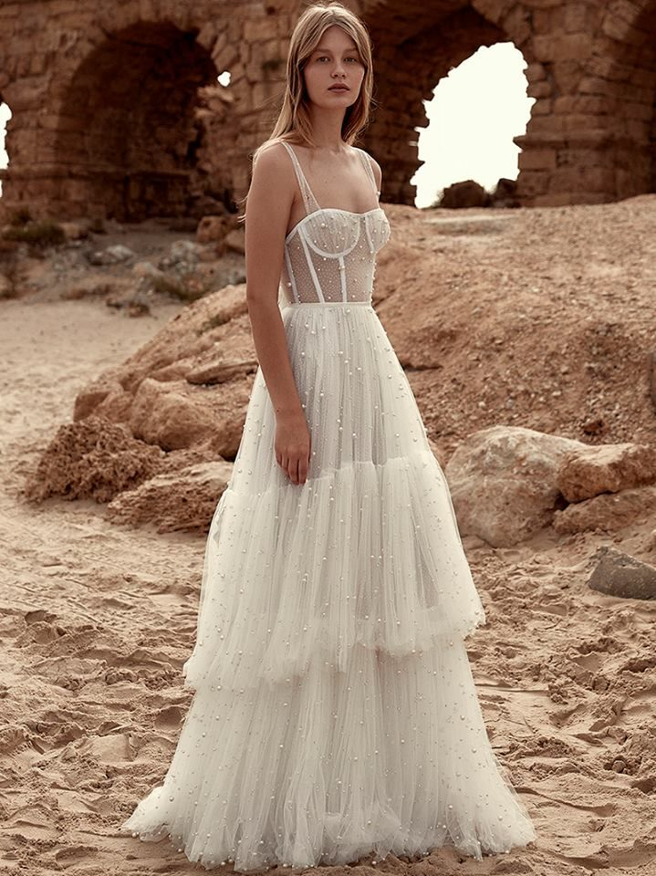 Dana Harel This Fairytale Tulle Gown Features An Exposed Corset And Tiered Skirt Covered With Shimmering Bridal Dresses Wedding Dresses Dream Wedding Dresses