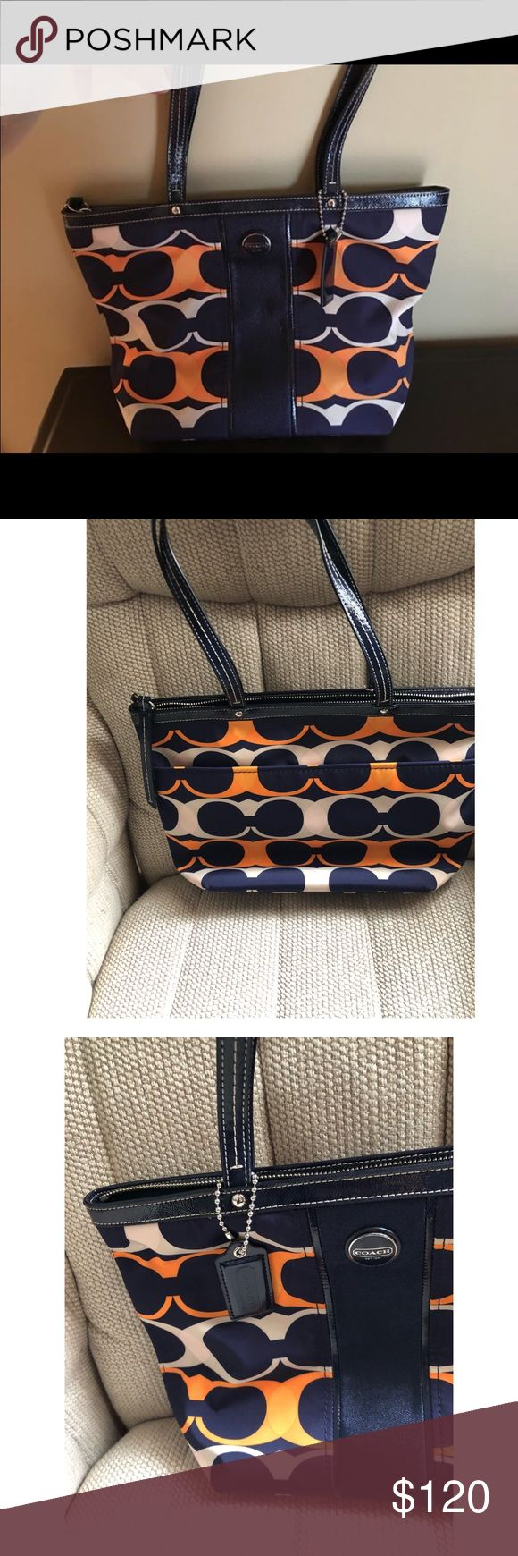 "Coach signature stripe medium Tote Coach signature Stripe Linear Navy blue and orange.barely used like new 13""by 8"" material Nylon Coach Bags Totes"