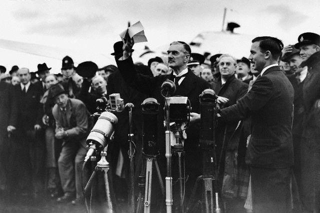 British Prime Minister Chamberlain proclaiming 'peace for our time' before the press at Heston Aerodrome near London, England, United Kingdom, 30 Sep 1938