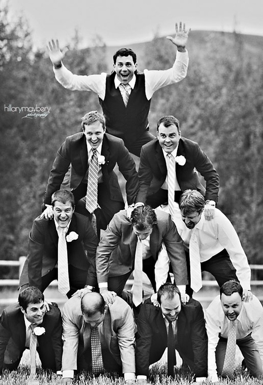 such a cool photo for the groom and his groomsmen...and ushers. Might have to have ring bearer on top
