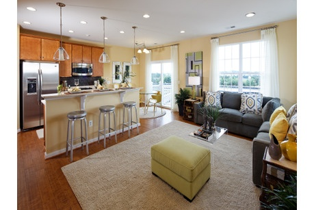 The open great room and sleek, adjoining kitchen of the Dylan model create a great spot to entertain. Newly built homes from K. Hovnanian Homes at Dulles Parkway Center in Ashburn, VA.