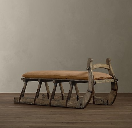 An old sleigh with a cushion used in the bathroom as a bench - pretty cool.  Maybe a little higher, but I like the idea