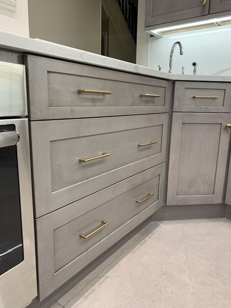 accessorize with gold hardware for a glam touch kitchendesign kitchenideas ki kitchen on kitchen remodel gold hardware id=39064