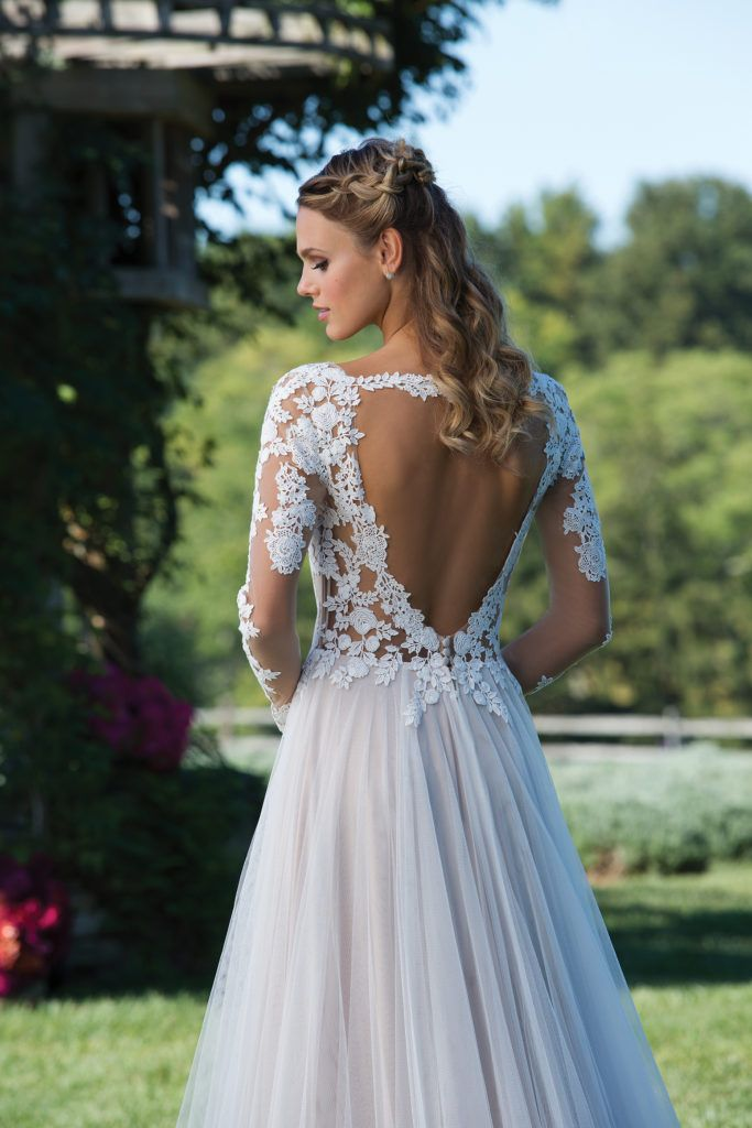 Sincerity Bridal 3972 - Illusion sleeves with tattoo lace that could not be more on trend. This soft A-line silhouette features a lace V-neckline and the tulle skirt moves flawlessly; perfect for the princess-like bride - The Blushing Bride boutique in Frisco, Texas