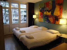 Guide to Amsterdam's top 4 cheapest hotels if you're traveling on a budget all with rooms under 100€ per night.