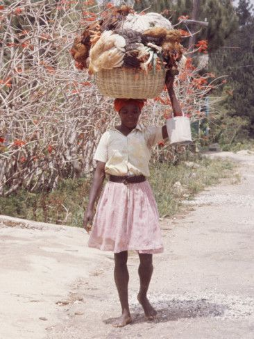 Haitian Woman Carrying Large Basket with Her Market ...