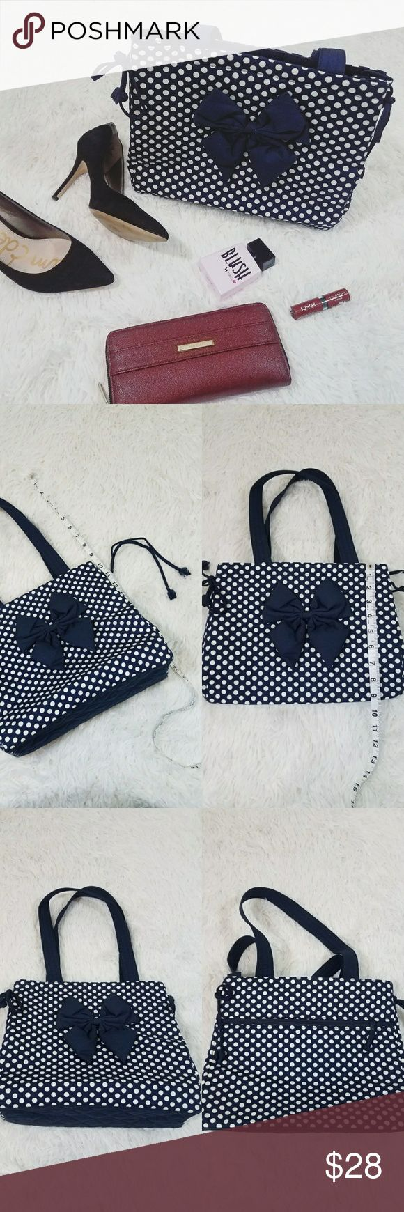Blue and White Polka Dot Shoulder Bag Excellent condition. Never used.   Blue and White polka dot. Bow on front.   Draw strings on sides to tighten bag.   All zippers work. Three pockets inside. Zipper pocket on outside.   Bought from Thailand. Great quality.   Could be used as a lunch bag, small diaper bag, purse, etc. Bags Shoulder Bags