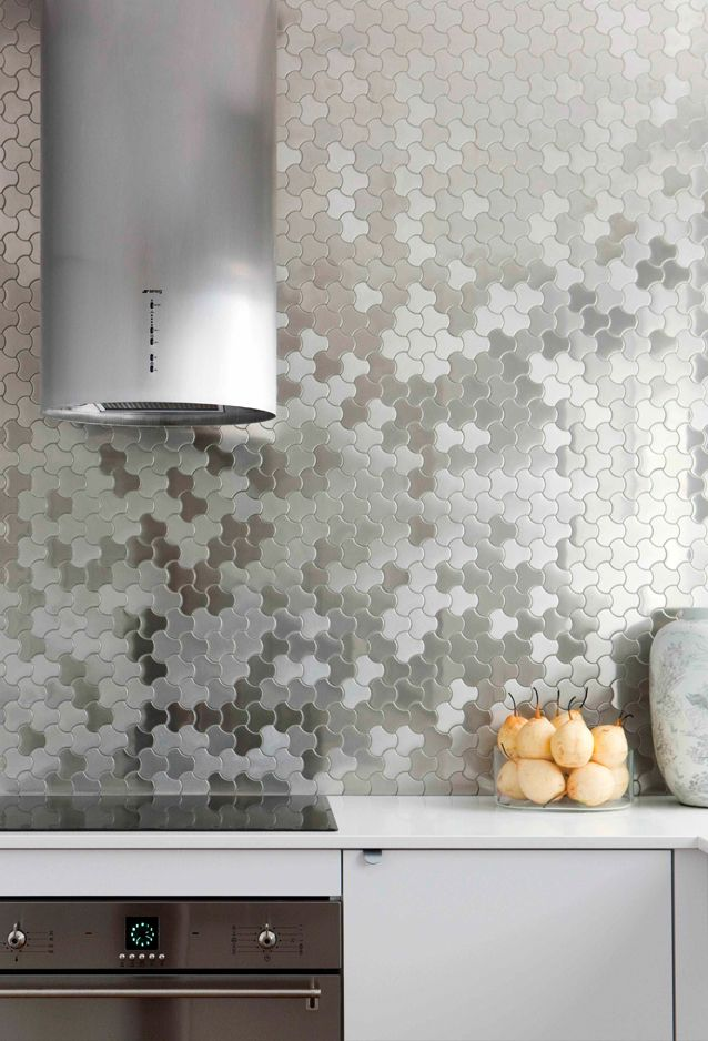 futuristic kitchen features karim for alloy ubiquity mosaic tile in brushed stainless steel tile backsplash framing cylinder shaped range hood over high end