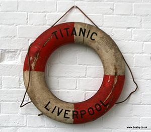 A 'life ring' buoyancy aid with the title 'TITANIC LIVERPOOL' written across it.