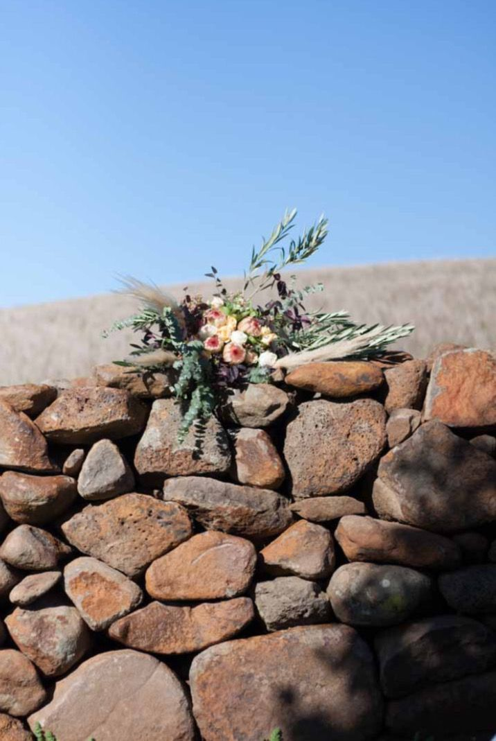 Boho Wedding bouquet by Bettie bee blooms Photo by: @alexphotoandfilm Pompas grass, proteas, unstructured, native bouquet
