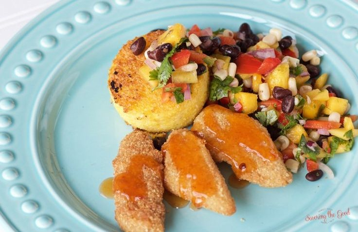 These are fish tenders for grown ups. Make a complete meal with a cheesy polenta cake with a generous helping of black bean mango salsa. You will be amazed at how simply this delicious meal comes together.