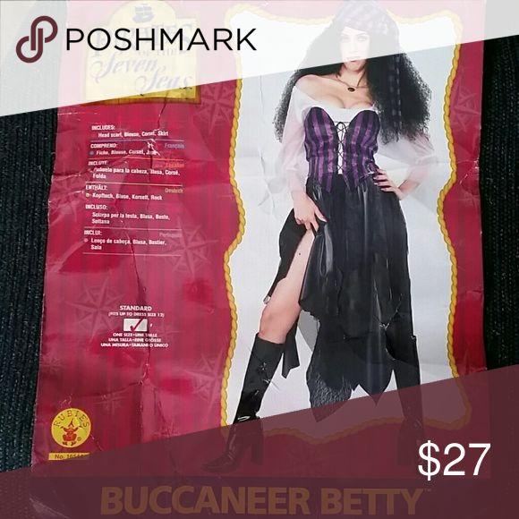 Ladies Pirates costume - with skirt,vest,scraf Ladies pirate costume size medium It comes with skirt (not quit as long as pic shows on package but I'm 5 ft 9. It comes with white off shoulder blouse, purple and black lace up vest ,black and purple scarf. Worn couple times. Unique costume not like other ladies pirate costumes. Pirates of the Seven Seas Other