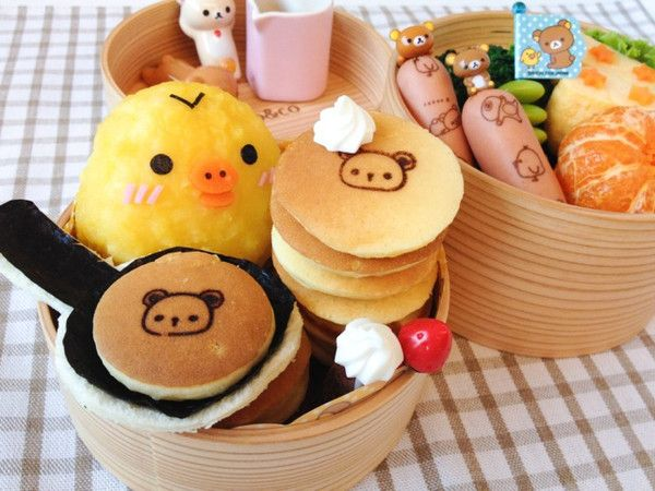 Kiiroitori Pancake Bento  A cheery pancake bento to start the day!  Kiiroitori is the yellow chick character from the popular Rilakkuma San-X series. But the highlight for me was the mini pancakes that I made! Aren't they cute?  http://en.bentoandco.com/blogs/news/10588045-kiiroitori-pancake-bento