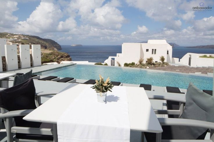 Enjoy the sunshine and the stunning view to the Aegean by the pool! ambassadorhotelsantorini.com/ambassador_photos/