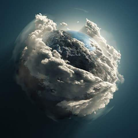 Earth In Her Cradle of Clouds... 'Namaste' from The Hubble Telescope..