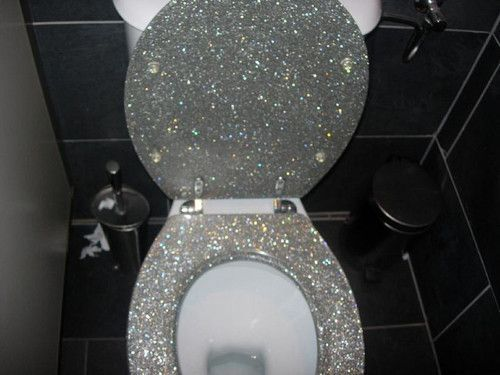 Yes, that is a glitter-covered toilet seat. Fit for a princess.