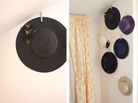 Hanging  Hats Display made with clothespins and adhesive. Great idea! I might paint the clothespins and hang my jewelry instead of hats!