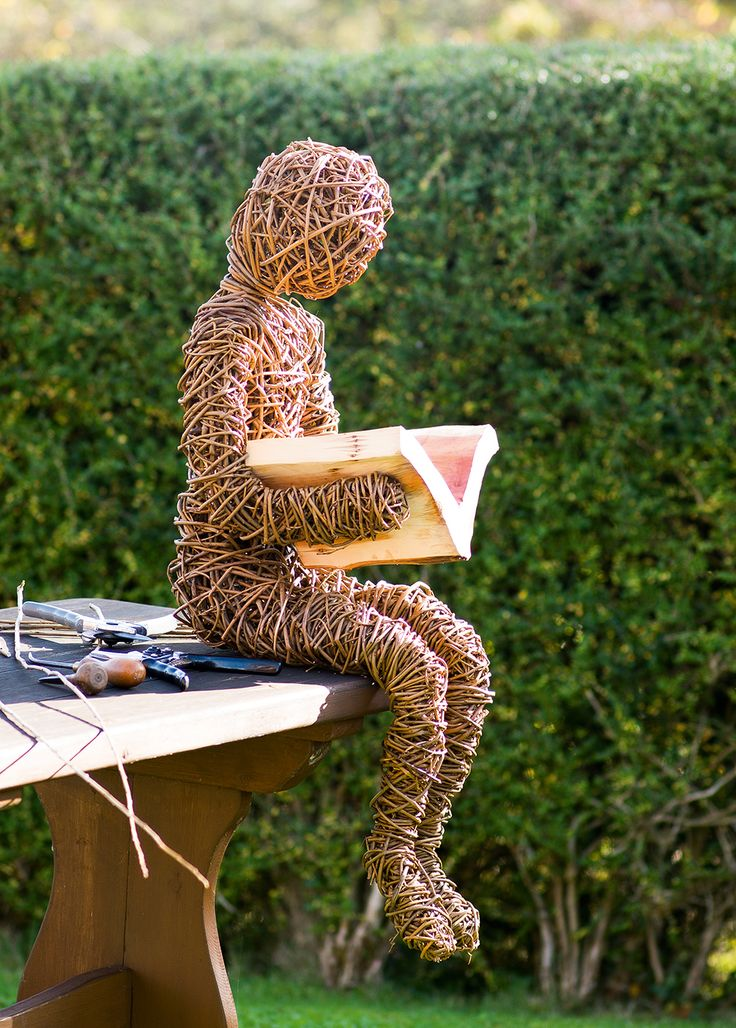 Woven sculpture of person reading