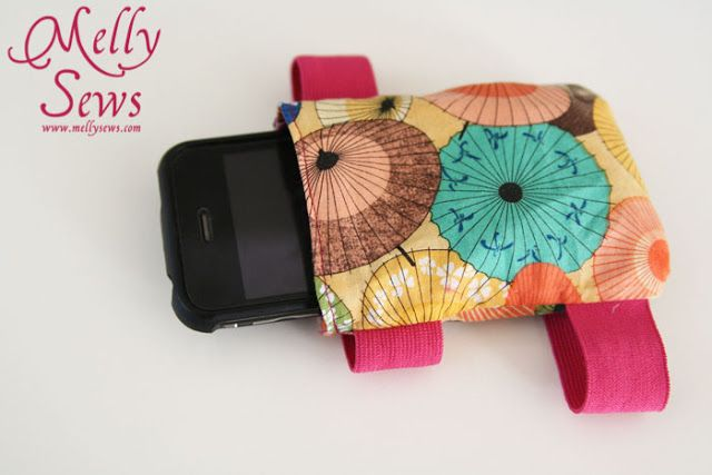 can make this fit iphone...super cute & easy!  http://mellysews.com/2012/10/ipod-arm-band.html  Ipod Arm Band - Melly Sews