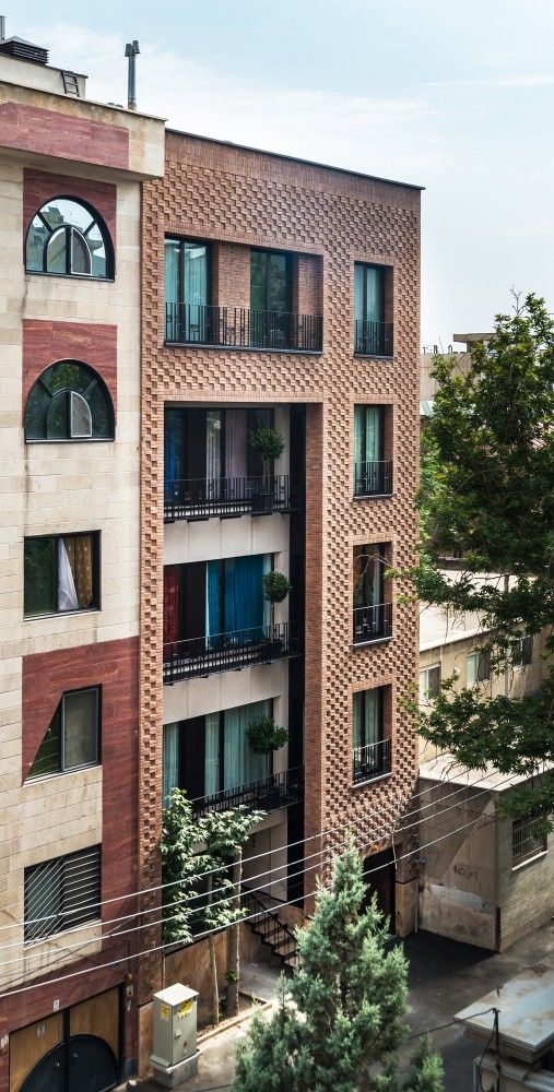 Haghighi Residential Building / Boozhgan Architecture Studio + AAD Studio | Brick