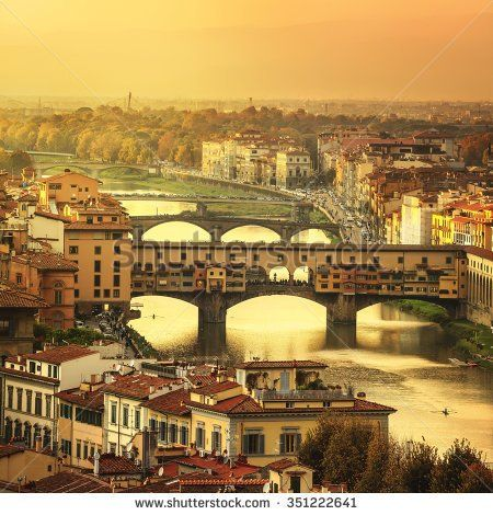 Florence or Firenze sunset Ponte Vecchio bridge. Panorama view from Michelangelo park square. Tuscany, Italy