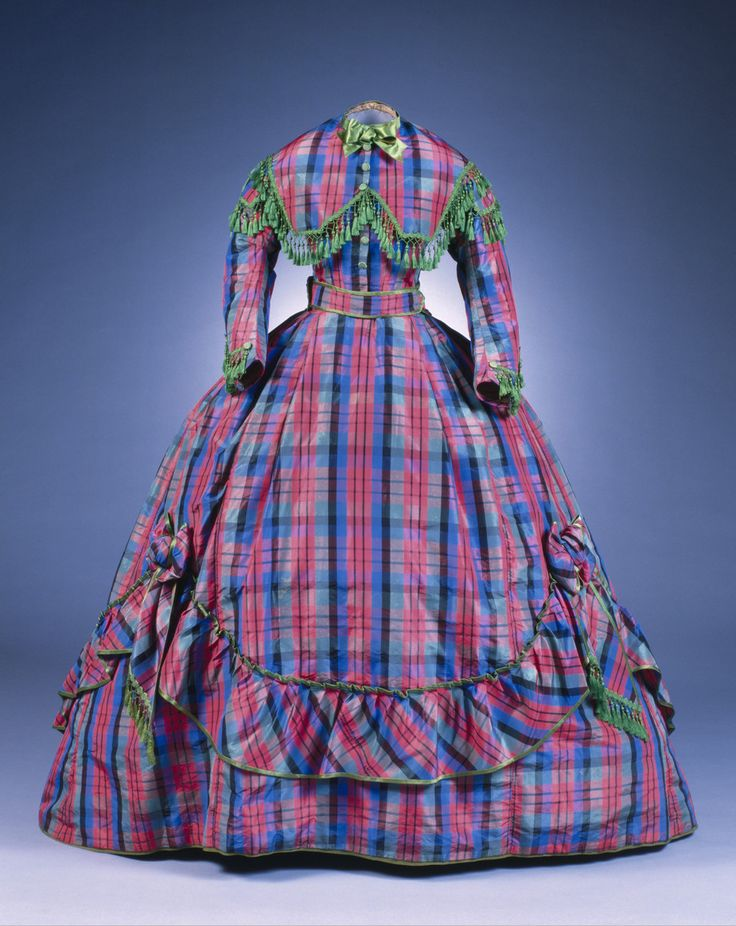 1865-67 plaid silk taffeta dress with two bodies, shown with evening body. (I thought the English were renowned for loving a bright mix of color during this period, but the Germans may have had them beat!) Cologne Museum of Applied Art.
