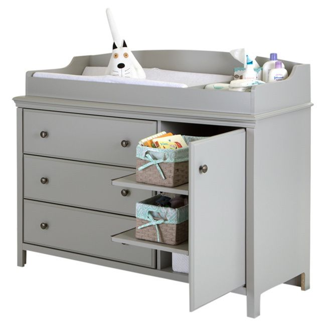 Complete your baby's room decor with this beautiful changing table. Featuring metal knobs in a brushed nickel finish, this changing table is sure to please.