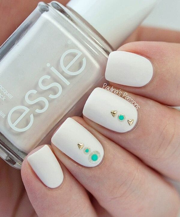 Recreate this beautiful even though simple nail art design. Pick a matte white as the base (a little off is good), add some polka dots in silver glitter and then add another dot in the middle in sea green. Then add some gold studs and you're done.