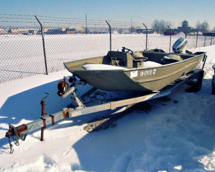 An Od Green Military Surplus Polar Kraft 18ft Aluminum Jon