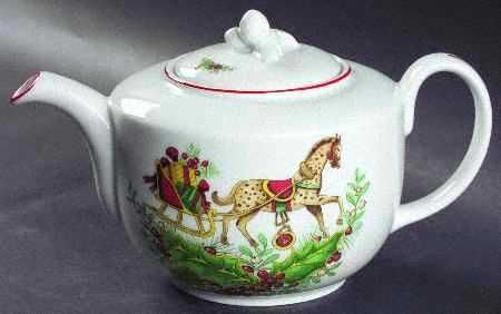Vista Alegre Christmas Magic pattern teapot ... decorated with toy horse pulling sleigh packed with Christmas presents, red band edging rim and spout, c. 2000s, porcelain, Portugal