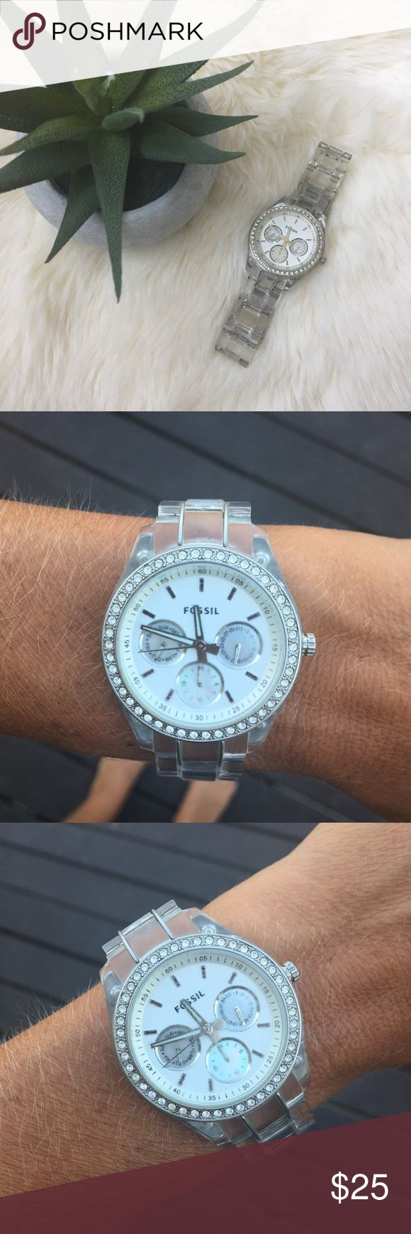 Gorgeous Fossil watch Beautiful detailed fossil watch with plated faux diamond surround. Face features month, day, and 24 hour clock. Band features clear wrist plates with a silver clasp in back. Excellent condition! Fossil Accessories Watches